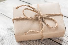 vintage gift wrap vintage gift box brown paper wrapped with rope on wood background