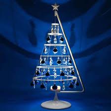 white christmas tree decorations blue ne wall