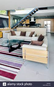 the interior spaces of a modern house on the cliffs overlooking