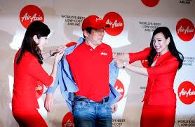 airasia uniform we will go where no one goes says airasia chief rediff com business