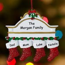 family around tree ornament tree and ornament