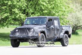 2019 jeep wrangler pickup truck jt wrangler truck testing on public roads shows spare tire mount