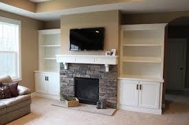 home design built in bookshelves fireplace windows wainscoting