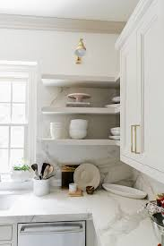white kitchen cabinets with gold pulls use knobs or pulls for unique kitchen cabinet hardware