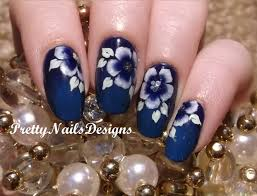 white u0026blue one stroke flowers on dark blue background nail art