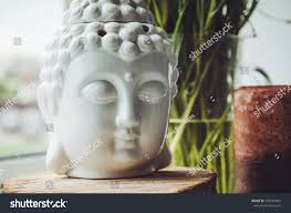 buddha inspired home decor zen spiritual ritual meditating white face stock photo 455561881