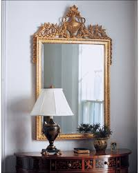 carved wood framed wall empire style mirror and empire decorative mirror with urn