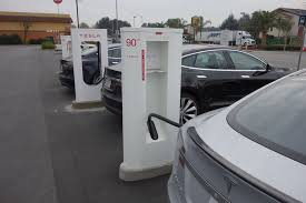 tesla details supercharging fees for new buyers the verge