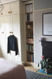 built in wardrobe with shelving in a minimal scandi style bedroom