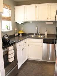 white kitchen cabinets laminate countertops grey laminate countertops transitional kitchen sherwin