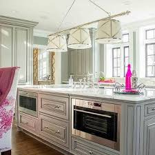 gray and pink kitchen with two islands lit by grosvenor linear