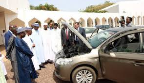 where is peugeot made photos of president buhari inspecting made in nigeria peugeot cars