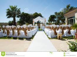 small wedding tent in garden with chairs on lawn royalty free