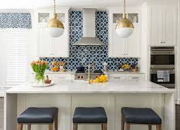 white kitchen cabinets with blue tiles before and after a dramatic kitchen and family room