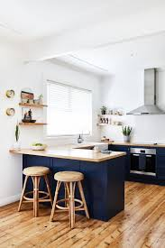 blue kitchen cabinets with wood countertops global wanderer adore home magazine wood countertops
