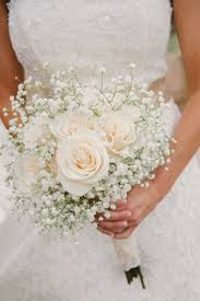 bouquets for wedding a simple bouquet of ivory roses and baby s breath photo via