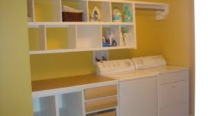 very small basement laundry room design with yellow wall interior