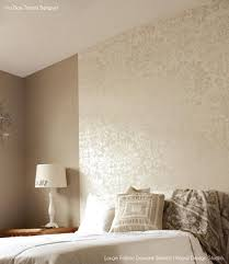stencil a headboard wall for an elegant guest bedroom design