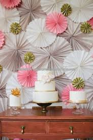 hanging paper fans pink gray hanging paper fans party idea lovely pastel dessert