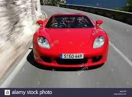 porsche front view car porsche carrera gt model year 2005 red convertible open
