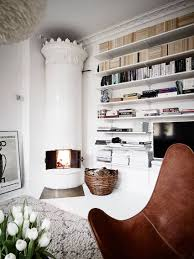 neutral living room with a floor to ceiling bookcase neutrals
