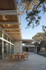 this modern house in texas is surrounded by oak trees contemporist
