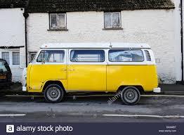 volkswagen minibus side view volkswagen camper van yellow hippy hippies camping vw festivals
