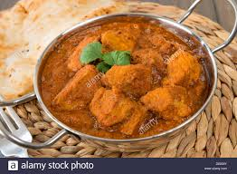 traditional cuisine goan pork vindaloo indian pork curry with naan bread