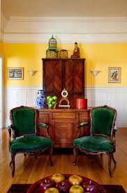 green velvet chair living room eclectic with armoire birdcage
