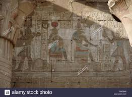 ancient egyptian wall paintings with figures and hieroglyphics hieroglyphics and mural paintings inside the ptolemaic temple of horus in the ancient city of edfu