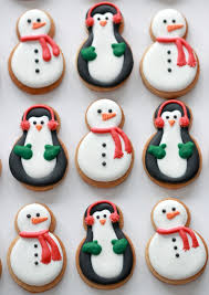 tutorial on decorating snowman and penguin cookies sweetopia