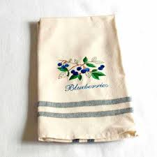 kitchen towel with blueberries branch embroidery by charlenesbags