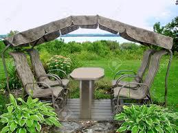 comfortable rocking chair in garden near river stock photo