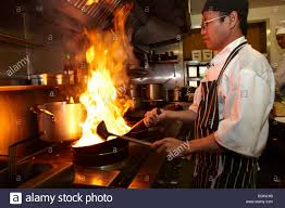 asian chef cooking in restaurant kitchen stock photo royalty free