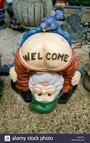 an ugly garden gnome at a nursery in auburndale queens new york
