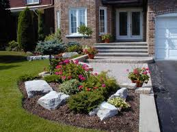 Landscaping Ideas For Front Yards by Small Front Yard With Red Mulches And Fountain Small Front Yard