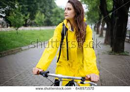 raincoat for bike riders bicycle ride rain young woman wearing stock photo 648571570