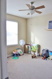 remodelaholic playroom makeover with built in cabinets for storage playroom makeover with built in cabinets before by delightfully noted featured on remodelaholic