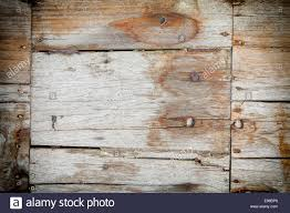 weathered wooden planks texture with cracks joins and nails in