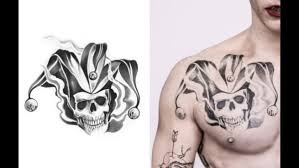 squad promo images showcase the joker u0027s tattoos