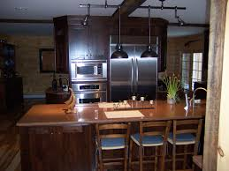 kitchen colors with oak cabinets and black countertops beadboard