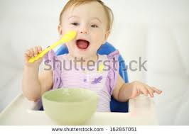 High Chair That Sits On Chair Baby Feeding Stock Images Royalty Free Images U0026 Vectors