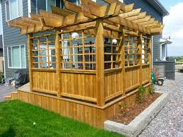 treated deck with custom privacy screen and pergola craftsman