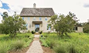 earthy materials agrarian architecture make this serenbe manor