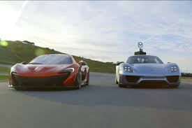 porsche mclaren p1 video 918 pulls above weight in track battle versus mclaren p1