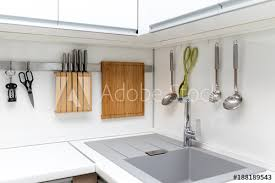 kitchen interior photo white glossy kitchen interior design with hanging utensils buy