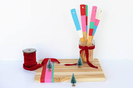 diy painted wooden utensils and a cute cutting board to match