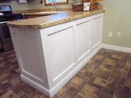 wainscoting kitchen island adding character to a kitchen island peninsula home staging in