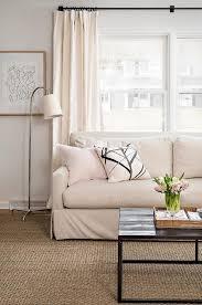 light tan living room soft subtle living room boasts a light tan skirted sofa adorned