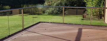 exterior goodman fence and wooden floor plus green grass for